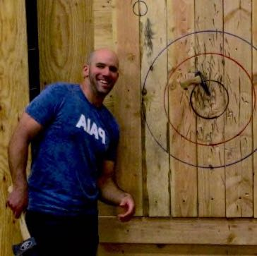 Play axe throwing games.